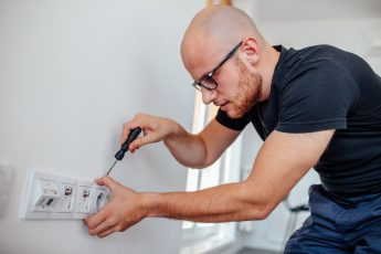 An Electrician Working